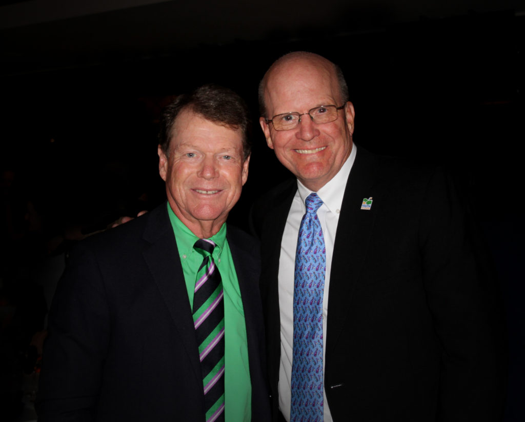 Tom Watson with one of the co-founders of Youth on Course